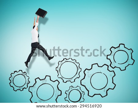 Businessman leaping with his briefcase against blue vignette background - stock photo