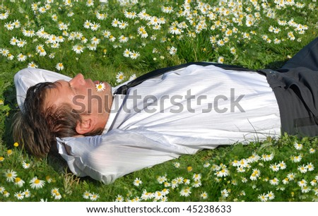 Businessman lie down and resting - stock photo