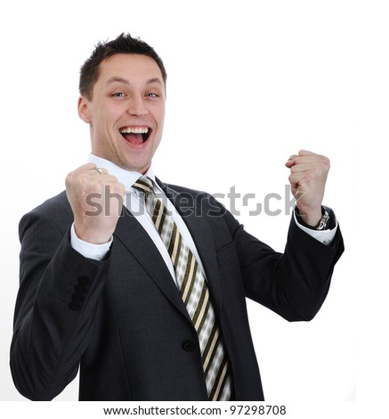 Businessman lifting arms in excitement - stock photo