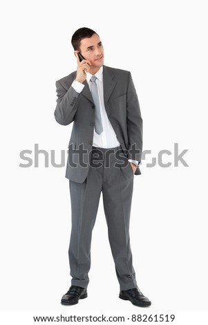 Businessman listening closely to caller against a white background