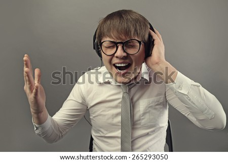 businessman listening to music - stock photo