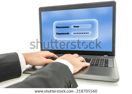 Businessman logging in on a laptop computer with the screen requesting his username and password as identification and security for access.