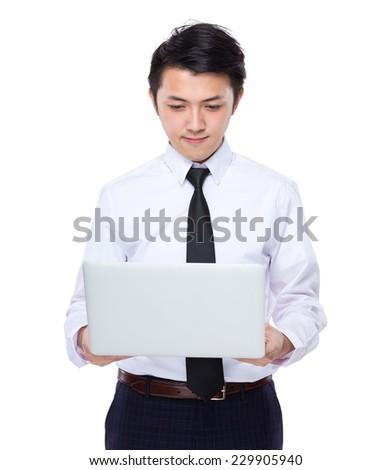 Businessman look at laptop - stock photo