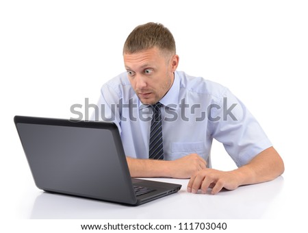 Businessman look at the screen laptop on white background - stock photo