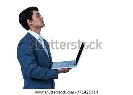 Businessman look away with his computer on white screen - stock photo