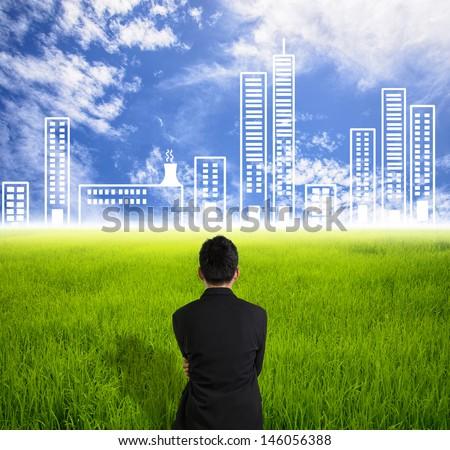 Businessman look city on skyline in future - stock photo