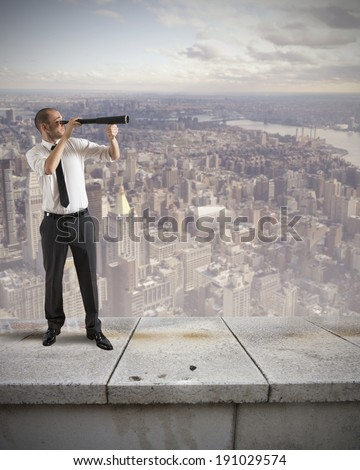 Businessman look for new business with binocular - stock photo