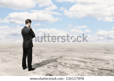 businessman looking and blue sky