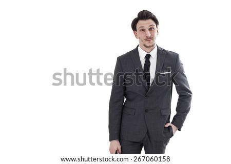 Businessman looking and smiling with hand in pocket