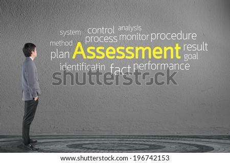 Businessman looking Assessment text wording in cloud concept