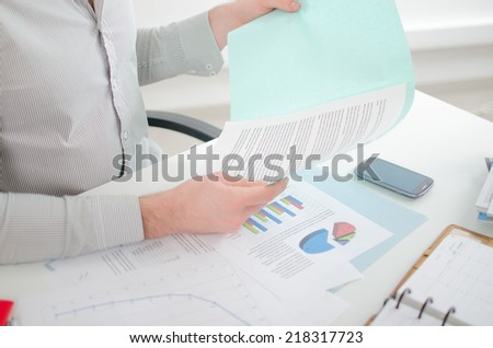 Businessman looking at a report at the office