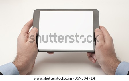 Businessman looking at a tablet device with blank screen