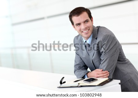 Businessman looking at appointments on agenda - stock photo