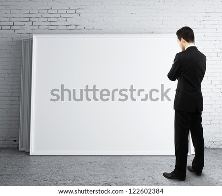 businessman looking at blank desk - stock photo