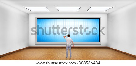 businessman looking at blank plasma tv on the wall in boardroom - stock photo