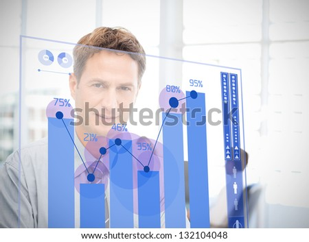 Businessman looking at blue chart interface with statistics