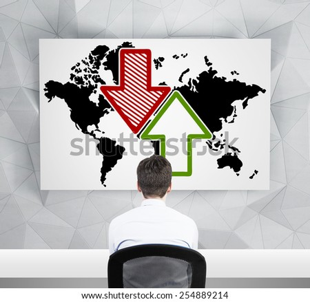 businessman looking at drawing world map with arrow on desk - stock photo