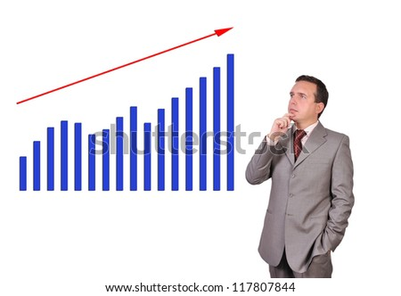 businessman looking at growth chart profit