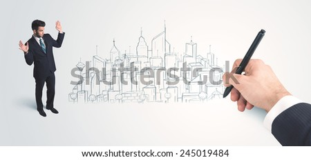 Businessman looking at hand drawn city on wall concept on background - stock photo