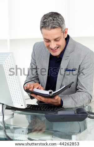 businessman looking at his calendar