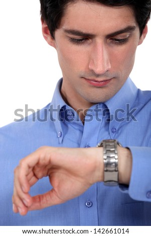 Businessman looking at his watch. - stock photo