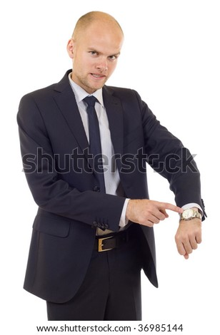 Businessman looking at  his watch  isolated on white