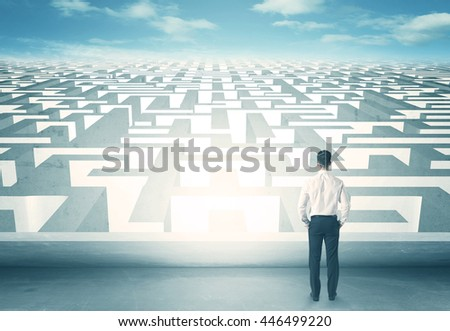 businessman looking at labyrinth - stock photo