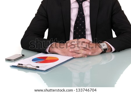 Businessman looking at marketing survey - stock photo