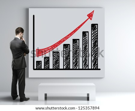 businessman looking at poster with growth chart - stock photo