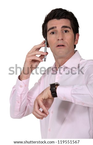 Businessman looking at the time