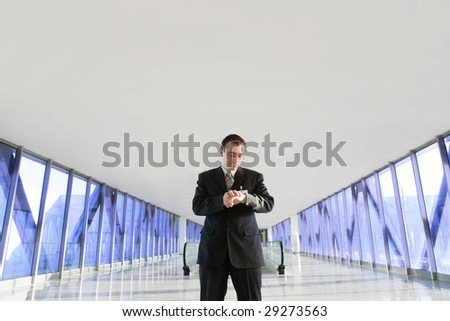 Businessman looking at watches at airport