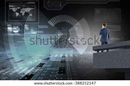 Businessman looking away against black and grey interface