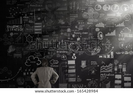 businessman looking business concept and strategy on dark texture wall background as concept - stock photo