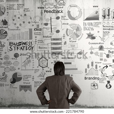 businessman looking business concept and strategy on texture wall background as concept  - stock photo