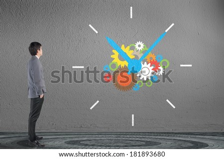 Businessman looking clock with gear as time for business concept