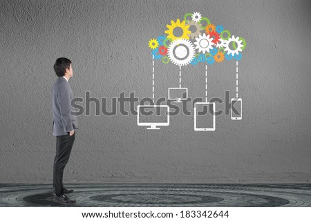 Businessman looking cloud computing network with gear and engine concept - stock photo