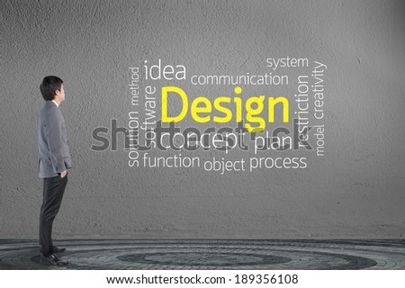 Businessman looking Design text wording in cloud concept