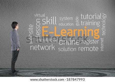 Businessman looking e - learning text wording in cloud concept