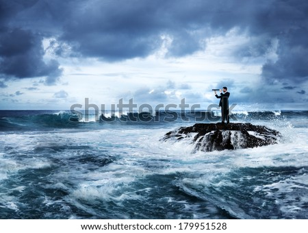 Businessman Looking For Opportunities by Stormy Ocean - stock photo