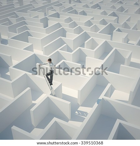 Businessman looking for the solution of the maze. Top view.  - stock photo