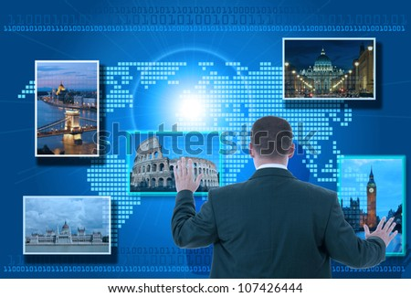 Businessman looking for tourism information using futuristic touch interface - stock photo