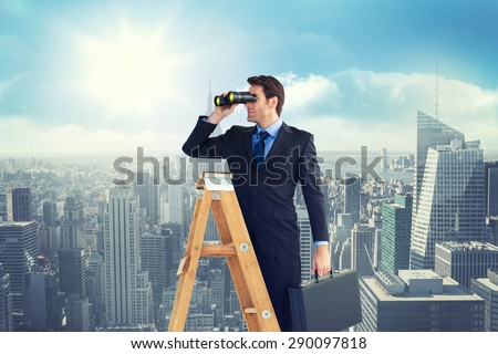 Businessman looking on a ladder against sunny city view - stock photo