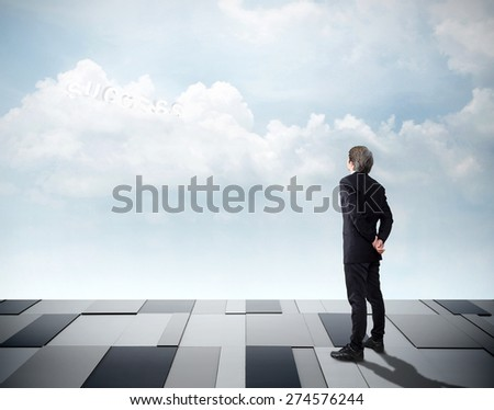 "Businessman looking on sky front and he see word ""free"" inside cloudy by ambitious. Business Concept"