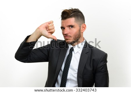 Businessman looking sad and showing thumb down