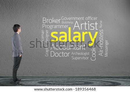 Businessman looking Salary text wording in cloud concept