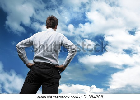 Businessman looking the blue sky and white clouds - stock photo