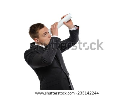 Businessman looking through a rolled paper. Business vision, or headhunters concept. - stock photo