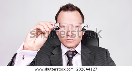 businessman looking through glasses