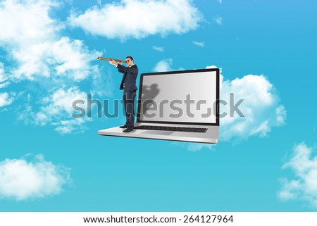 Businessman looking through telescope against blue sky - stock photo