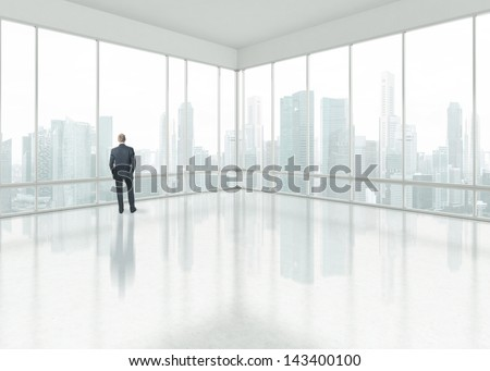 Businessman looking through the window - stock photo